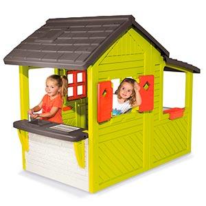niños jugando en smoby 310300 casa invernadero